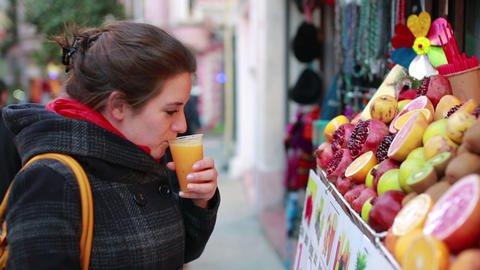 woman buy and drink juice Footage