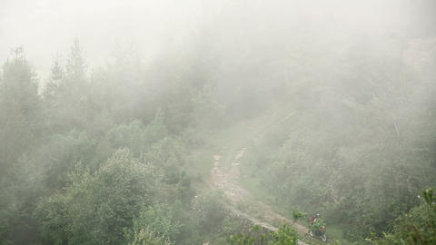 Man riding motorbike in mist, at himalayas Footage