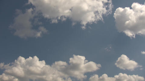 Timelapsed Clouds Quickly Drift Amidst A Blue Sky (High Definition) stock footage