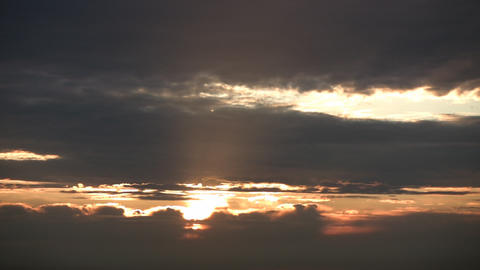 Morning scenic of a sunrise admist the clouds (High Definition) Footage