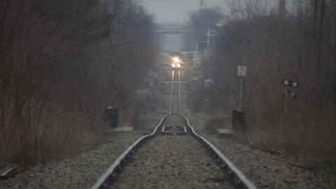 Timelapsed train moves down tracks as cars pass (High Definition) ビデオ
