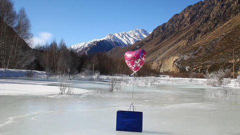 Blue Gift Package And The Helium Balloon Is On The stock footage