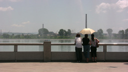Chinese Ladies Look Towards North Korea stock footage
