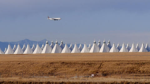 Airplane Flying Over Denver International Airport stock footage