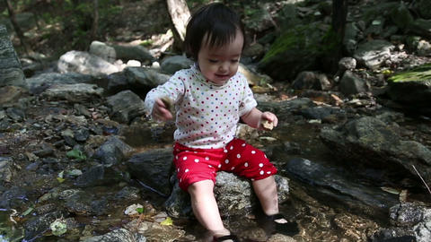 Baby Toddler 2 At The Creek stock footage