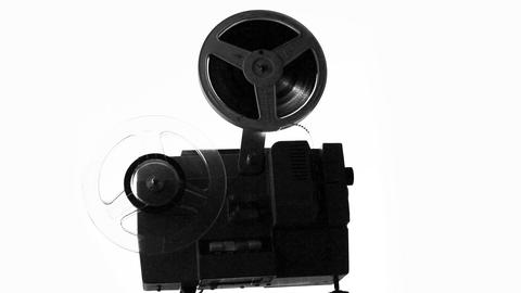 silhouette of old projector showing film Footage