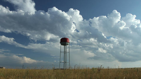 Time-lapse Clouds Over Water Tower stock footage