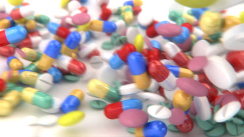 Pills and capsules dropped on a table, slides into Animation