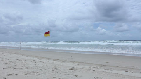 Lifeguard Flag On Sunny Gold Coast Beach With Surf stock footage