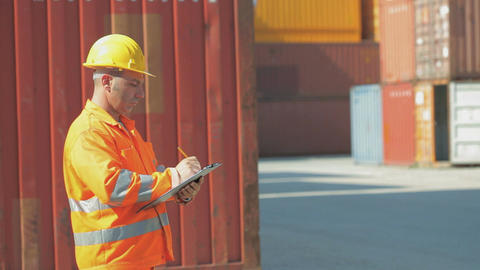 Manual Worker With Radio In Shipping Facility stock footage