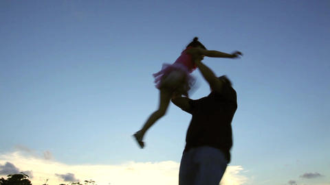 Father Rotate Little Girl With Sunset Background stock footage