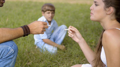 Little Boy Looking At Parents Smoking Cigarette Footage