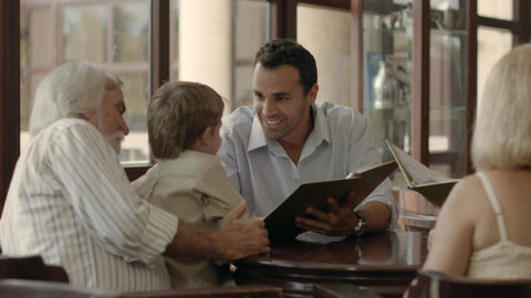 Three Generations Ordering Meal In Restaurant stock footage