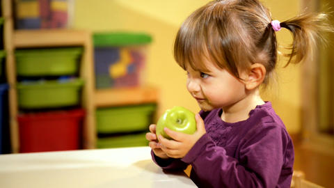 Child Eating Green Apple In Kindergarten stock footage