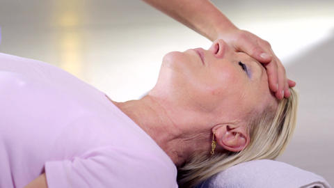 Therapist Doing Reiki Therapy and Mature Woman Footage