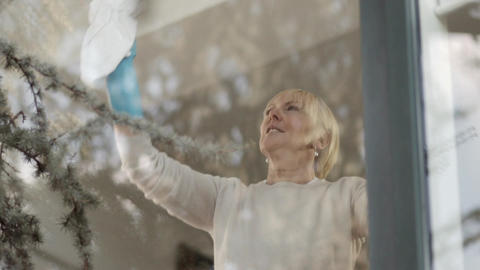 Senior Woman Doing Chores At Home stock footage