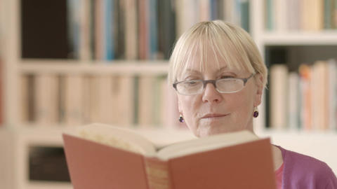 Senior Woman Reading Book At Home stock footage