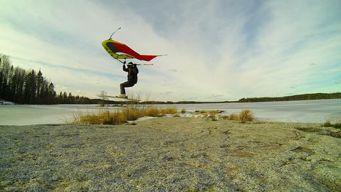Kitewing Skier Jumping Over A Rock In Slow Motion stock footage