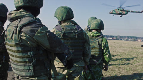 Soldiers And Helicopter Landing stock footage