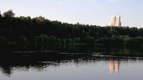 Evening in park, lake, mirror with building at background Footage