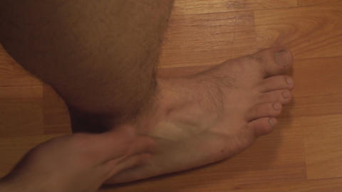 Man Massaging Ankle, Ankle Injury, Pain, Treatment stock footage