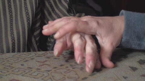 Elderly Woman And Her Grand Daughter Hands stock footage