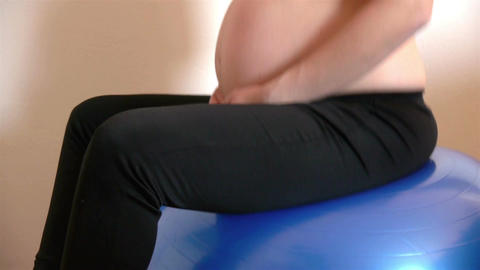 Pregnant woman on exercise ball Footage