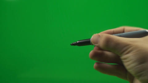 Man Opening A Marker And Then Drawing With It On A Footage