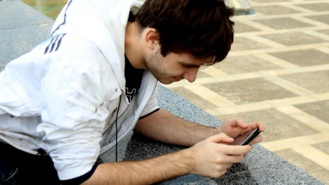 Young Man Using Smartphone stock footage