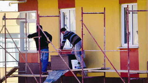 Workers Fixing Insulation Panels On Facade stock footage