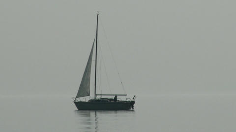 Small Sailing Boat In Lake Misty Weather 1 stock footage