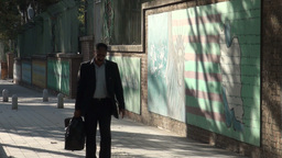 Tehran, man walks past former US Embassy compound Footage