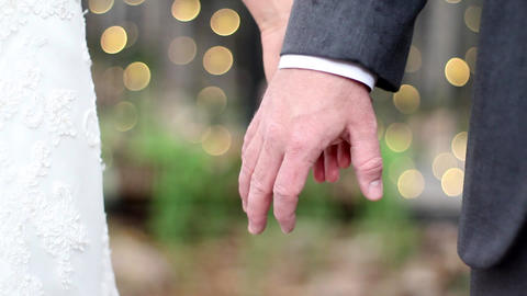 Wedding hand hold bokeh Footage