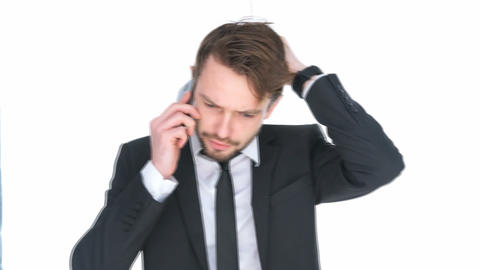 Puzzled Businessman Talking On A Mobile stock footage