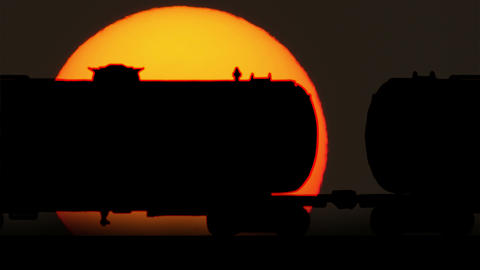 Freight Train Oil Tankers Cars Against Sunrise stock footage