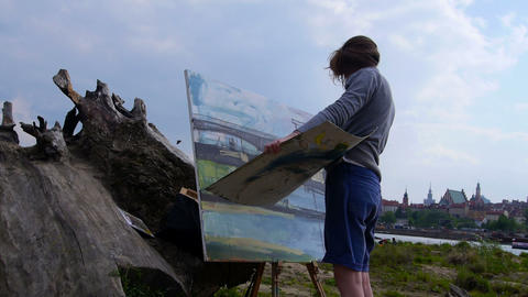 Woman Paints A Picture Outdoors stock footage
