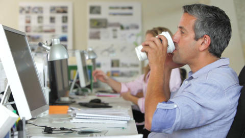 Man At Desk With Mobile Phone Drinking Coffee stock footage
