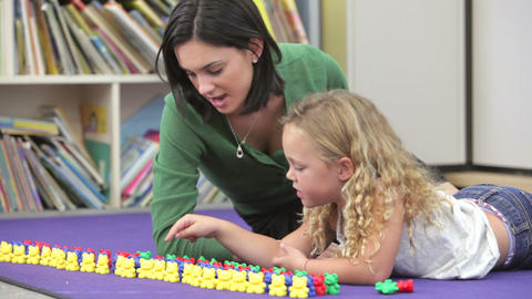 Teacher Showing Girl How To Count With Plastic Toy Footage