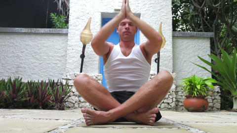 Man Doing Yoga Exercises Outdoors At Health Spa stock footage