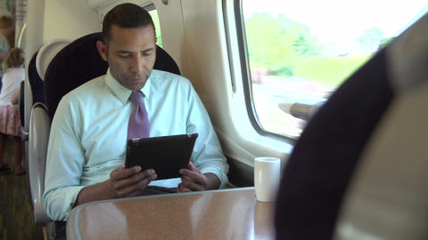 Interior Of Busy Commuter Train With Businesspeopl stock footage