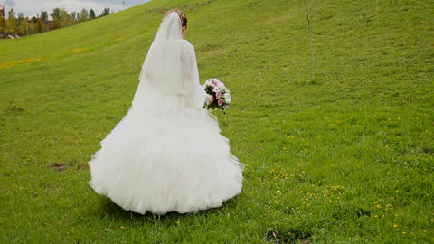 Bride Walks Around The Hill stock footage