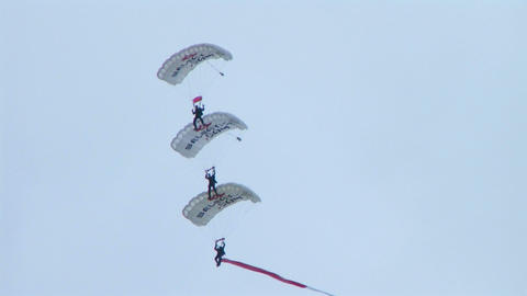 Skydivers Parachuting In Formation stock footage