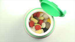 Opened Bottle Of Pills On A White Background, Medi stock footage