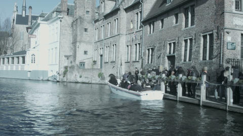 People sit in a boat on the river. Bruges, Belgium Footage