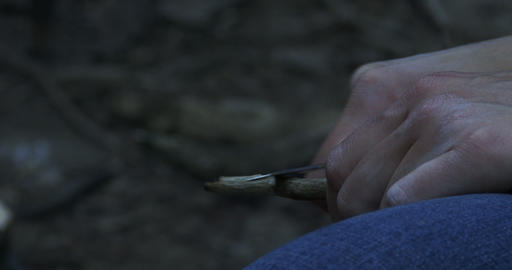Woman Sharpening Stick During Camping stock footage