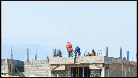 construction workers on a house on Cape Verde Footage