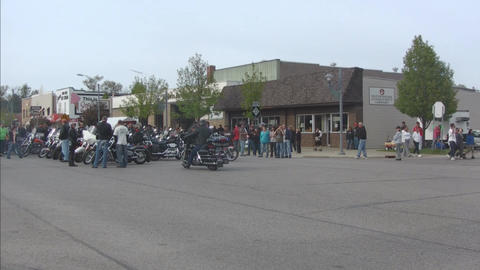Motorcycle Group Parked In Main Street stock footage