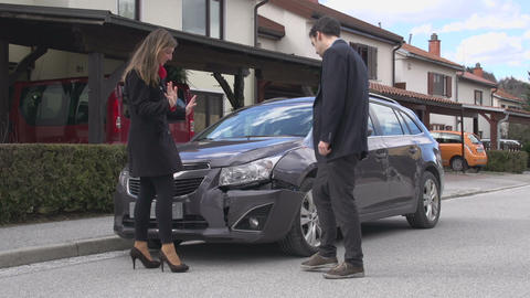 Man And Woman Yelling At Each Other After Car Cras stock footage