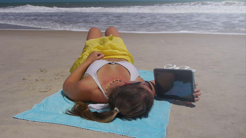 Young Woman Reading Digital Tablet On Vacations stock footage