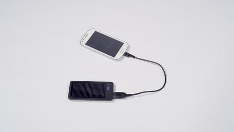 Charging smartphone with solar cell phone charger Footage